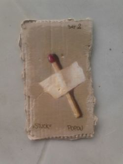 """Stuck"", painting of matchstick, acrylic on cardboard (6cm x 10cm)"