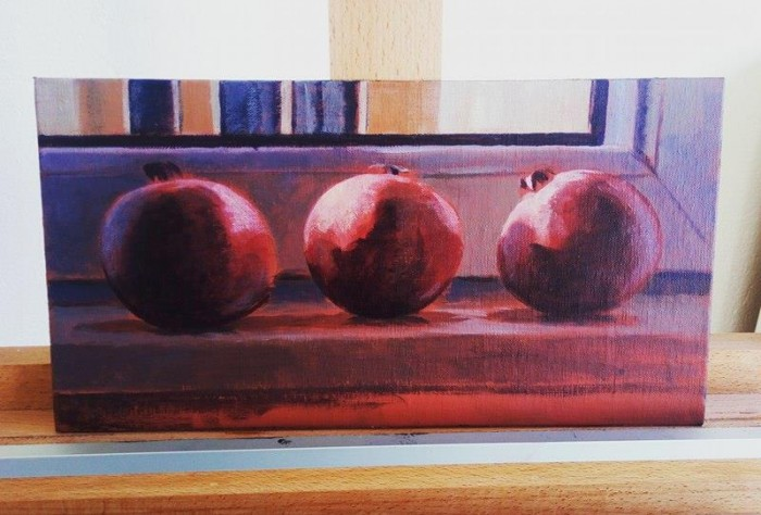 Painting of pomegranates in progress